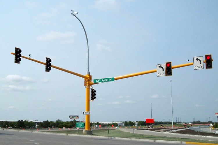 Inclined beam traffic signal light pole